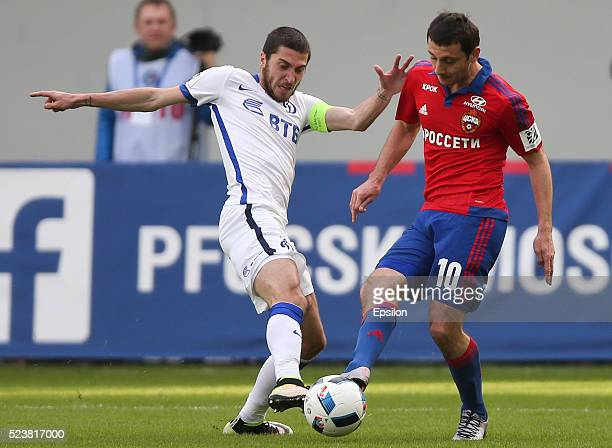Alan Dzagoev of PFC CSKA Moscow challenged by Aleksei Ionov of FC Dinamo Moscow during the Russian Premier League match between PFC CSKA Moscow and...