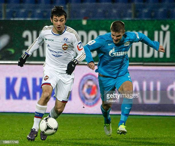 Alan Dzagoev of PFC CSKA Moscow vies for the ball with Igor Denisov of FC Zenit St Petersburg during the Russian Football League Championship match...