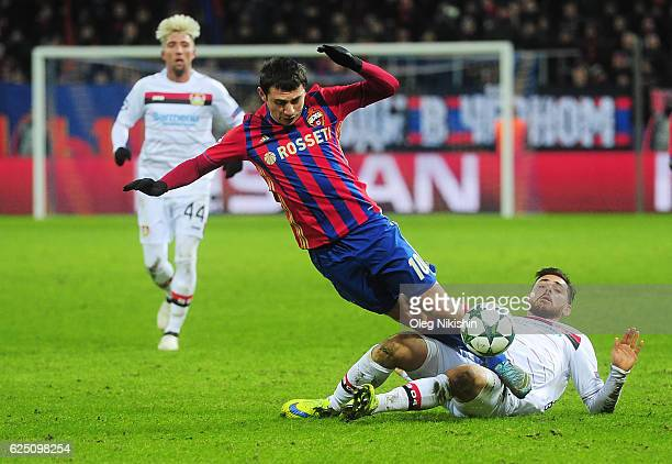Alan Dzagoev of PFC CSKA Moskva and Kevin Volland of Bayer 04 Leverkusen compete for the ball during the UEFA Champions League match between PFC CSKA...
