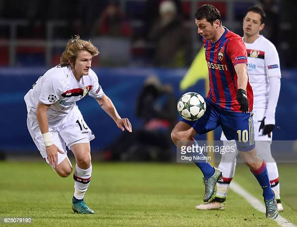 Alan Dzagoev of PFC CSKA Moskva and Tin Jedvaj of Bayer 04 Leverkusenvie for the ball during the UEFA Champions League match between PFC CSKA Moskva...