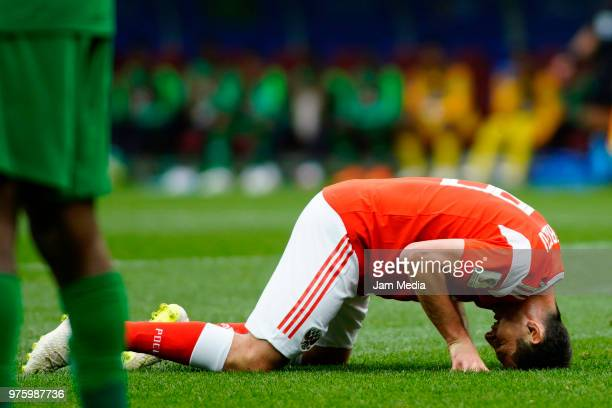 Alan Dzagoev of Rusia reacts after an injury during the 2018 FIFA World Cup Russia group A match between Russia and Saudi Arabia at Luzhniki Stadium...
