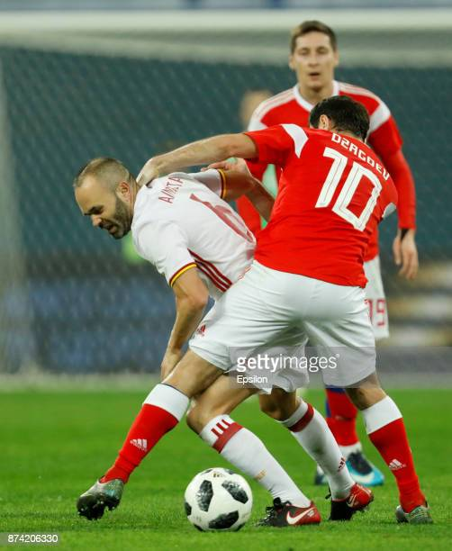 Alan Dzagoev of Russia and Andres Iniesta of Spain vie for the ball during Russia and Spain International friendly match on November 14 2017 at Saint...