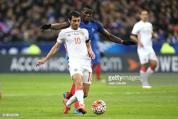 Alan Dzagoev of Russia and Paul Pogba of France in action during the international friendly match between France and Russia at Stade de France on...
