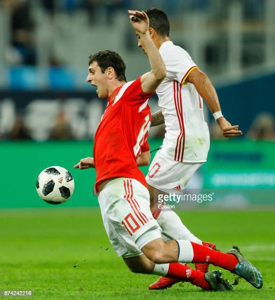 Alan Dzagoev of Russia and Thiago Alcantara of Spain vie for the ball during Russia and Spain International friendly match on November 14 2017 at...