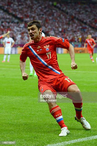 Alan Dzagoev of Russia celebrates scoring the first goal during the UEFA EURO 2012 group A match between Poland and Russia at The National Stadium on...