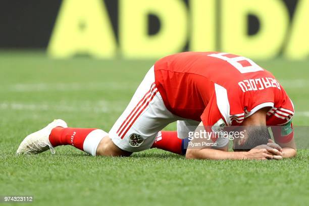 Alan Dzagoev of Russia goes down injured during the 2018 FIFA World Cup Russia Group A match between Russia and Saudi Arabia at Luzhniki Stadium on...