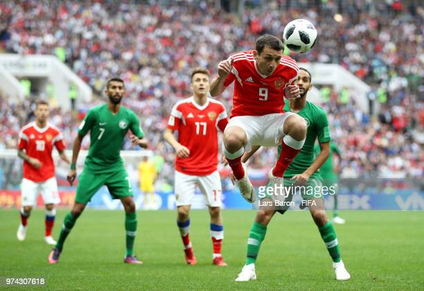 Alan Dzagoev of Russia heads the ball clear during the 2018 FIFA World Cup Russia Group A match between Russia and Saudi Arabia at Luzhniki Stadium...