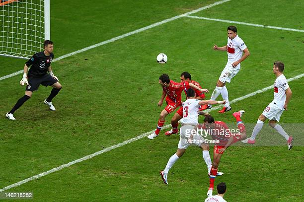Alan Dzagoev of Russia heads the ball to score the first goal during the UEFA EURO 2012 group A match between Poland and Russia at The National...