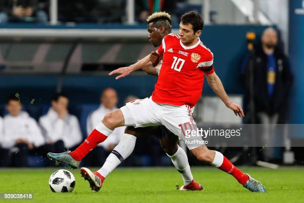 Alan Dzagoev of Russia national team and Paul Pogba of France national team vie for the ball during the international friendly football match between...