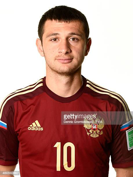 Alan Dzagoev of Russia poses during the Official FIFA World Cup 2014 portrait session on June 9 2014 in Sao Paulo Brazil