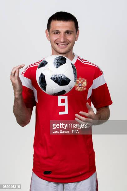 Alan Dzagoev of Russia poses for a portrait during the official FIFA World Cup 2018 portrait session at Federal Sports Centre Novogorsk on June 8...