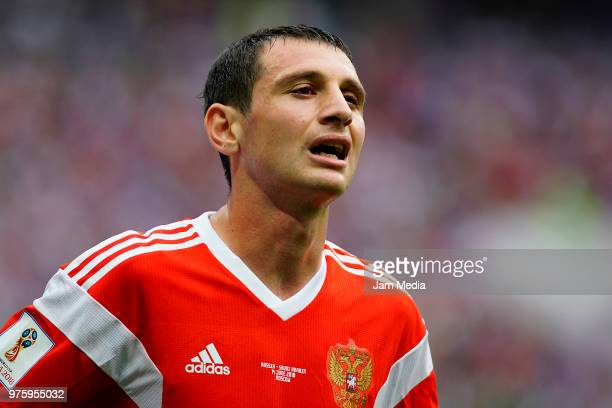 Alan Dzagoev of Russia reacts after being injured during the 2018 FIFA World Cup Russia group A match between Russia and Saudi Arabia at Luzhniki...