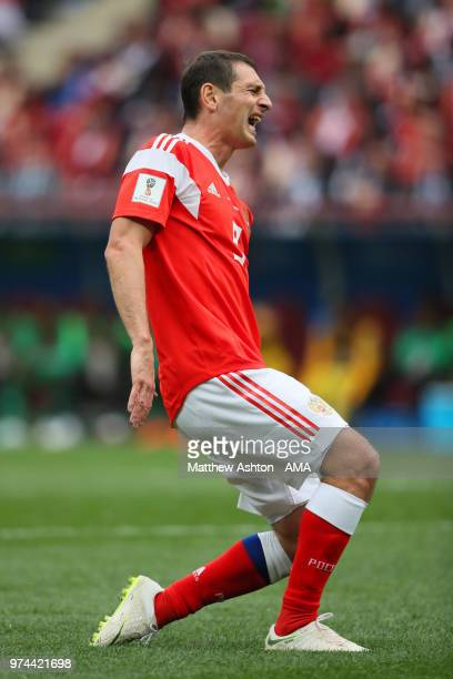 Alan Dzagoev of Russia reacts to an injury during the 2018 FIFA World Cup Russia group A match between Russia and Saudi Arabia at Luzhniki Stadium on...