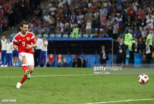 Alan Dzagoev of Russia scores his team's second penalty in the penalty shoot out during the 2018 FIFA World Cup Russia Quarter Final match between...
