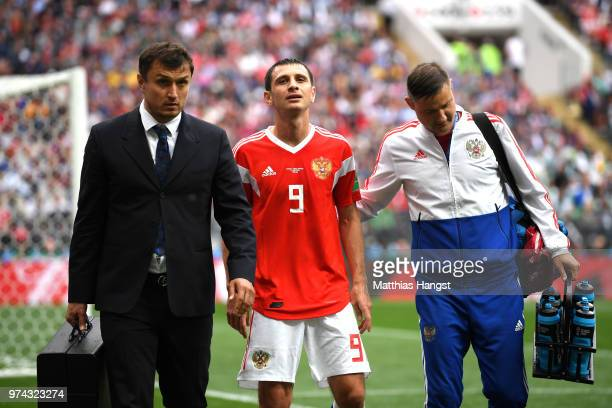 Alan Dzagoev of Russia walks off injured and is sustituted during the 2018 FIFA World Cup Russia Group A match between Russia and Saudi Arabia at...