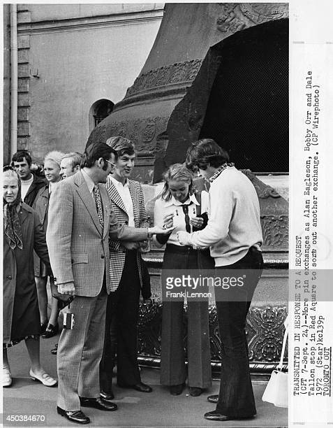 Alan Eagleson Bobby Orr and Dale Tallon stop in Red Square to sort out pins during the 1972 Summit Series between Canada and Russia in September 1972...