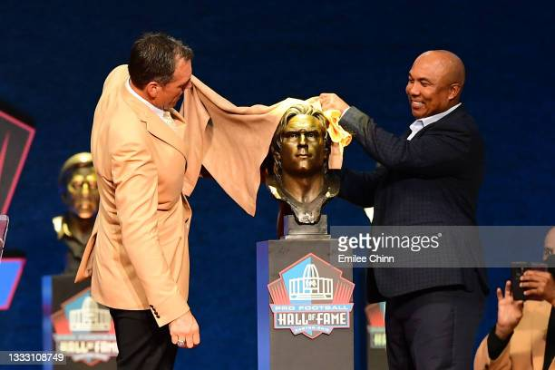 Alan Faneca unveils his bust with Hines Ward during the NFL Hall of Fame Enshrinement Ceremony at Tom Benson Hall Of Fame Stadium on August 08, 2021...