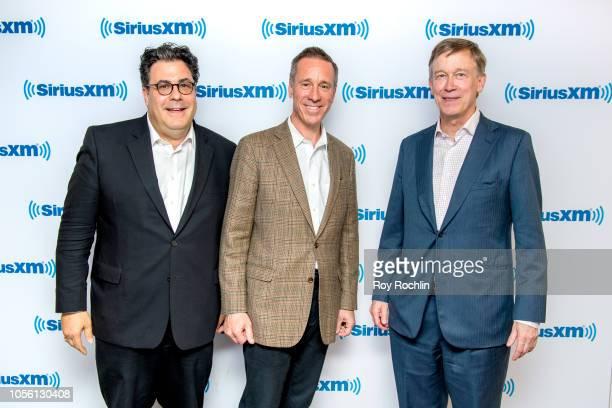 Alan Fleischmann Arne Sorenson and governor of Colorado John Hickenlooper visit SiriusXM Studios on November 1 2018 in New York City