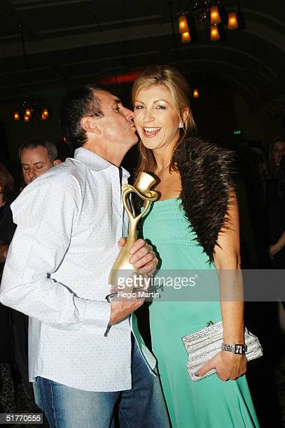 Alan Fletcher holding his Variety 2004 Outsanding Contribution Award and wife Australian news reader Jennifer Hansen attend the after party of the...