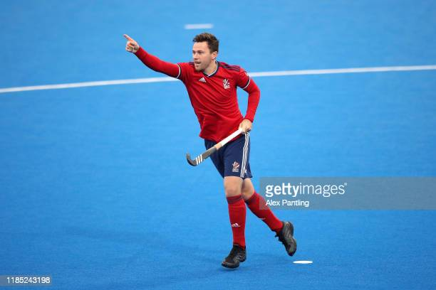 Alan Forsyth of Great Britain celebrates after he scores his sides first goal during the Olympic Qualifier match between Great Britain and Malaysia...