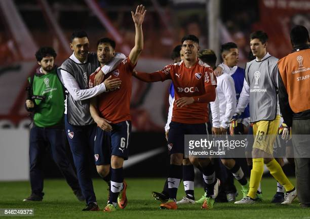 Alan Franco and Juan Sanchez Miño of Independiente celebrate after winning the second leg match between Independiente and Atletico Tucuman as part of...