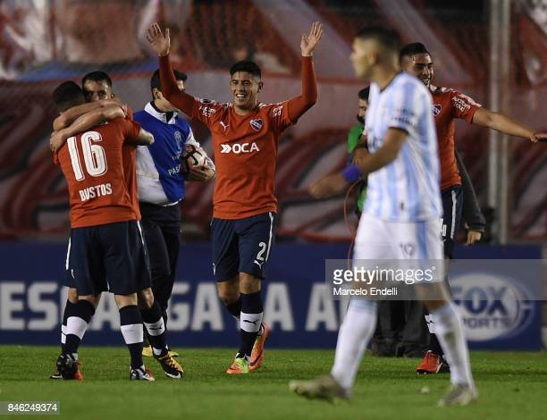 Alan Franco Diego Rodriguez and Fabricio Bustos of Independiente celebrates after winning the second leg match between Independiente and Atletico...