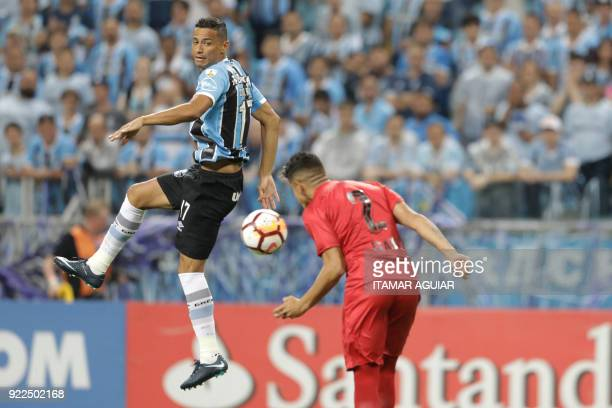 Alan Franco of Argentina's Independiente heads the ball with Cicero of Brazil's Gremio during their Recopa Sudamericana 2018 second leg final...