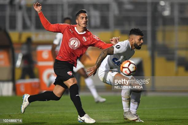 Alan Franco of Argentina's Independiente vies for the ball with Gabriel of Brazil's Santos during their 2018 Copa Libertadores football match held at...
