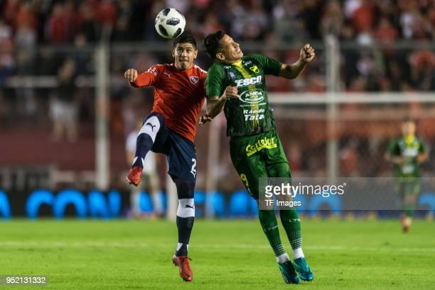 Alan Franco of Independiente and Fernando Marquez of Defensa y Justicia battle for the ball during a match between Independiente and Defensa y...
