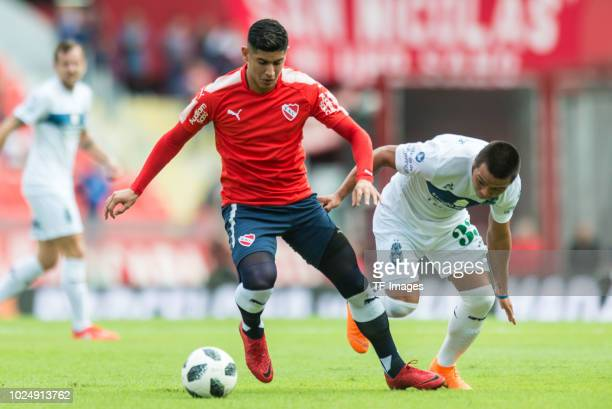 Alan Franco of Independiente and Matias Gomez of Gimnasia battle for the ball during the Primera Division match between Independiente and Gimnasia y...