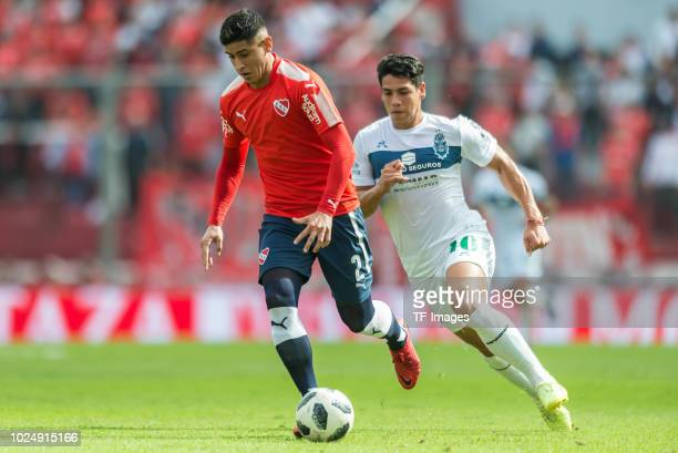 Alan Franco of Independiente and Nicolas Contin of Gimnasia battle for the ball during the Primera Division match between Independiente and Gimnasia...