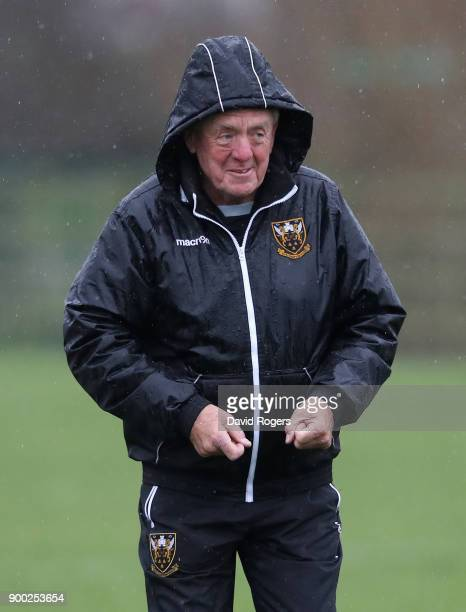 Alan Gaffney the Northampton Saints technical coaching consultant shelters from the rain during his first Northampton Saints training session held at...
