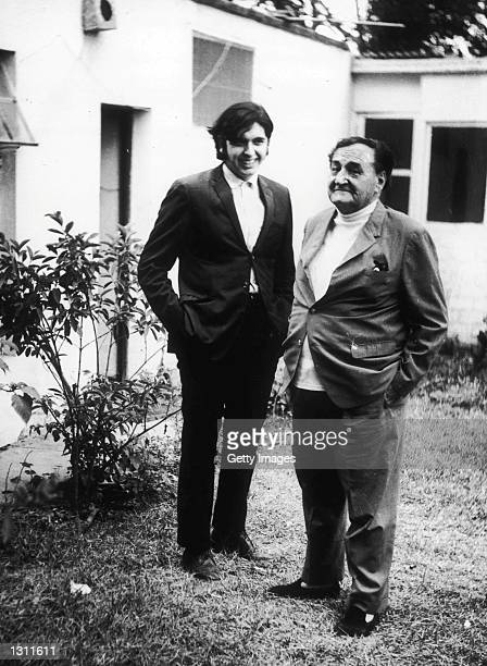 Alan Garcia left poses for a photograph with the leader of the APRA political party Raul Haya de la Torre in an undated photo Peruvian Presidential...