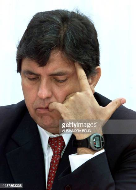 Alan Garcia presidential candidate of the Aprista Peruvian Party revises documents during a ceremony at a local political organization in Lima Peru...