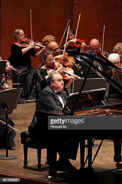Alan Gilbert leading the New York Philharmonic at Avery Fisher Hall on Thursday night January 2 2014This imageYefim Bronfman performing Magnus...