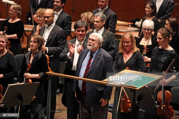 Alan Gilbert leading the New York Philharmonic at Avery Fisher Hall on Thursday night January 2 2014This imageThe composer Christopher Rouse center...