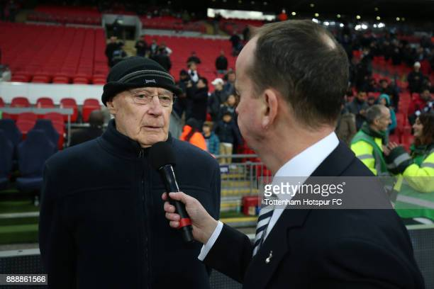 Alan Gilzean ex Tottenham Hotspur player is interviewed at half time during the Premier League match between Tottenham Hotspur and Stoke City at...
