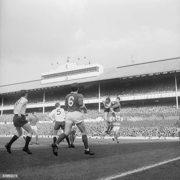 Alan Gilzean the Tottenham Hotspur centreforward and Pat Dunne the Manchester United goalkeeper go up for the ball during a match at White Hart Lane...