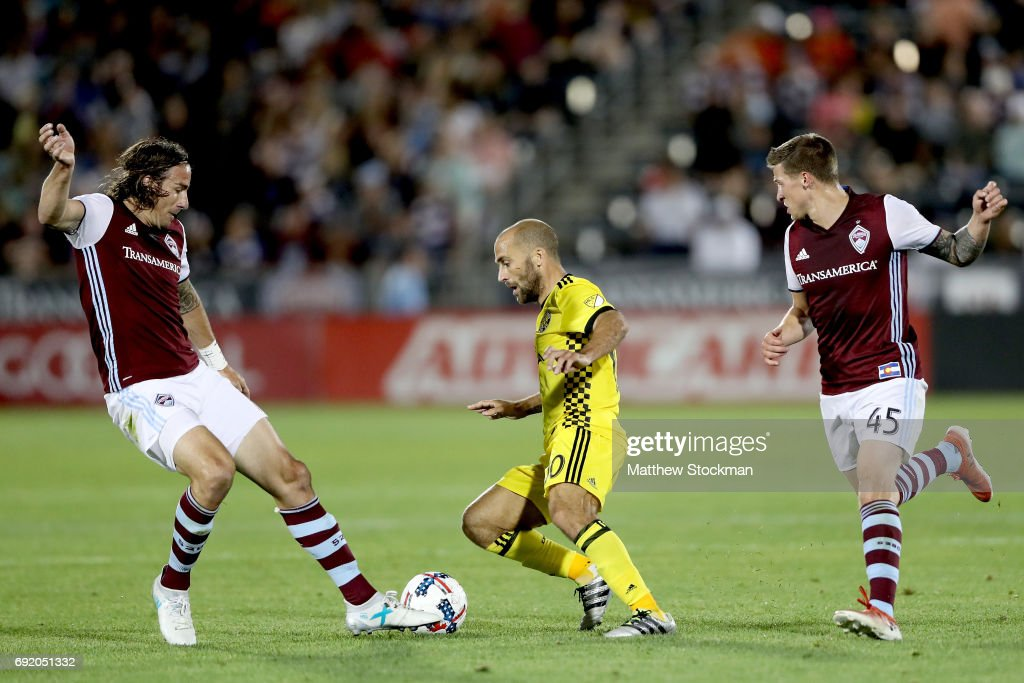 Alan Gordon @16 and Joshua Gatt #45 of the Colorado Rapids try to contain Federico Higuain #10 of Columbus Crew SC at Dick's Sporting Goods Park on June 3, 2017 in Commerce City, Colorado.