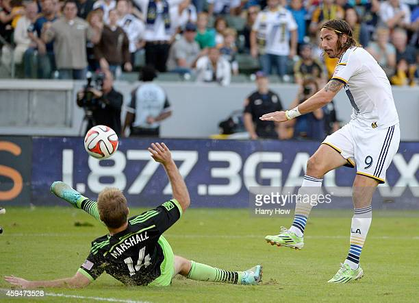 Alan Gordon of Los Angeles Galaxy has his shot blocked by Chad Marshall of Seattle Sounders FC during a 21 Galaxy win in the Western Conference Final...