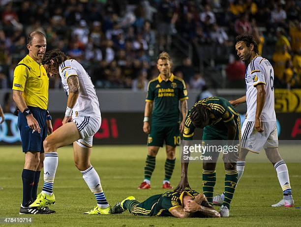 Alan Gordon of Los Angeles Galaxy shows Referee Ted Unkel the damage done by Liam Ridgewell of Portland Timbers lies on the ground during Los Angeles...