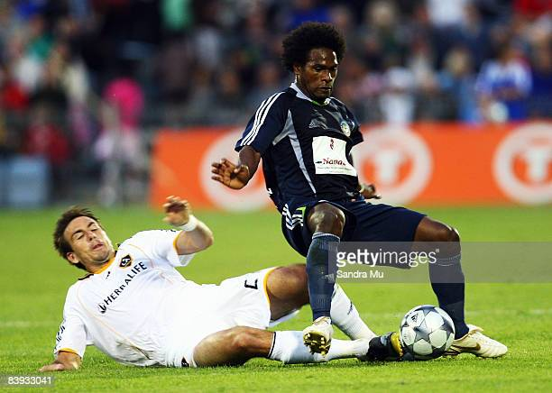 Alan Gordon of the LA Galaxy tackles David Muta of the All Stars during the match between the Oceania All Stars and the LA Galaxy held at Mount Smart...