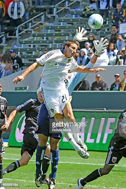 Alan Gordon of the Los Angeles Galaxy attempts a header against DC United during their MLS game at Home Depot Center on March 22 2009 in Carson...