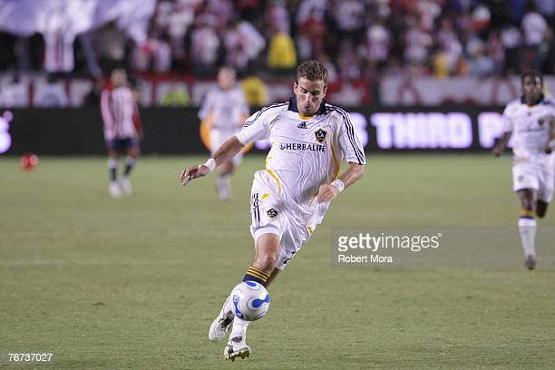 Alan Gordon of the Los Angeles Galaxy in action against the defense of Club Deportivo Chivas USA during their match on September 13 2007 at Home...
