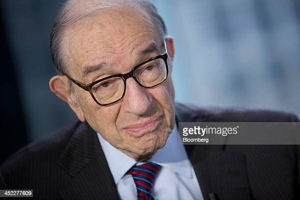 Alan Greenspan former Federal Reserve chairman and president and founder of Greenspan Associates listens to a question prior to a Bloomberg...