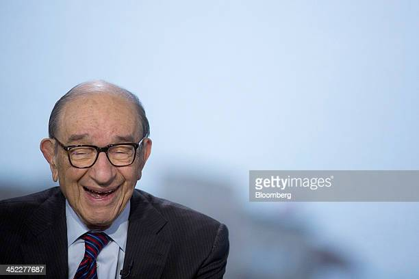Alan Greenspan former Federal Reserve chairman and president and founder of Greenspan Associates smiles prior to the start a Bloomberg Television...