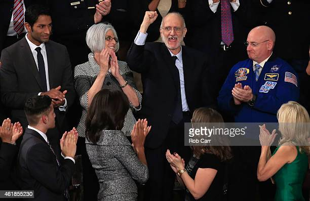 Alan Gross recently freed after being held in Cuba since 2009 pumps his fist after being recognized by US President Barack Obama during the State of...