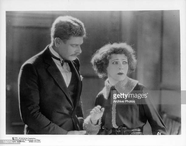 Alan Hale looking at the frighten look Alla Nazimova has on her face in a scene from the film 'A Doll's House' 1922