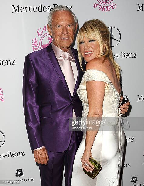 Alan Hamel and Suzanne Somers attend the 2014 Carousel of Hope Ball at The Beverly Hilton Hotel on October 11 2014 in Beverly Hills California