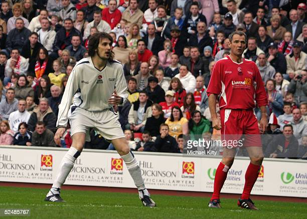 Alan Hansen and Sergio Pizzorno take part in the 'Liverpool Legends v Celebrity XI' Tsunami Fundraiser football match at Anfield football ground on...